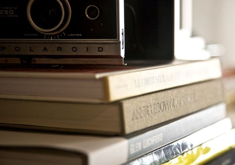 Camera sitting on top of books