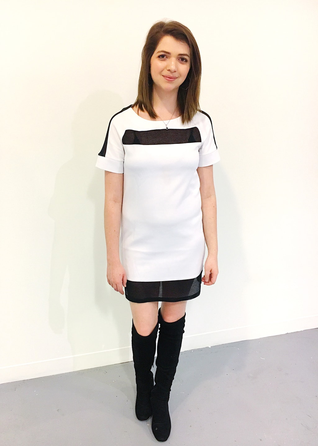 Fashion on campus at Columbus College of Art and Design: College student wearing a mod black and white shift dress and over-the-knee black boots