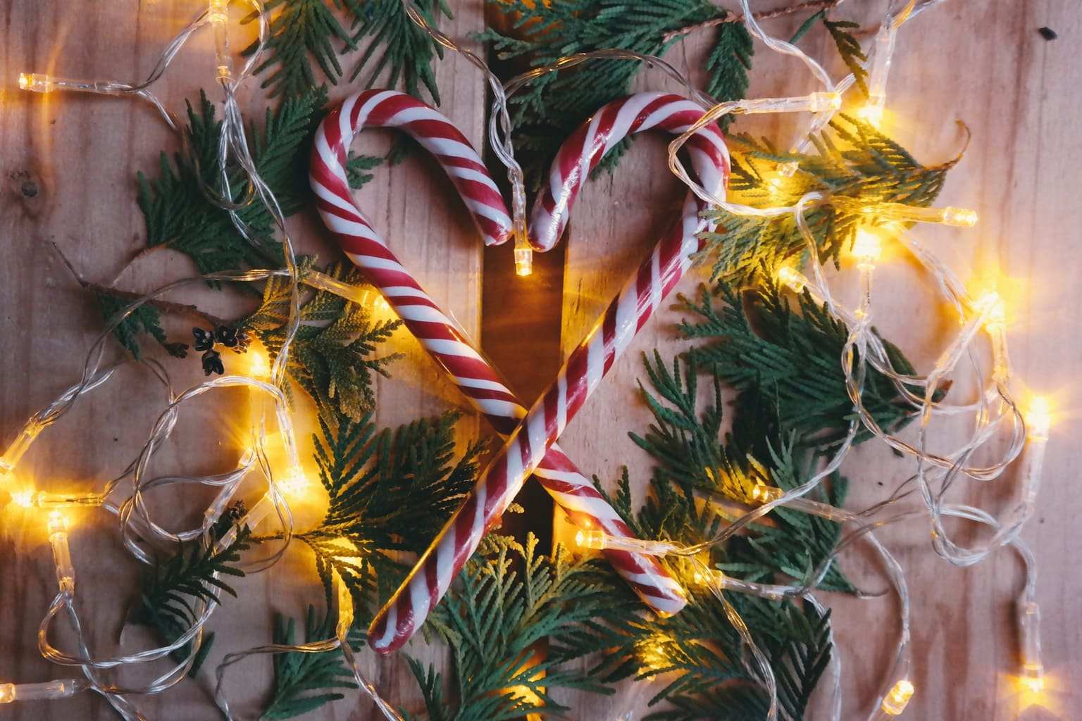 Two candy canes forming a heart as a Christmas decoration