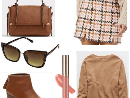 Pink skirt and lip gloss, brown sunglasses, handbag, boots and sweater.