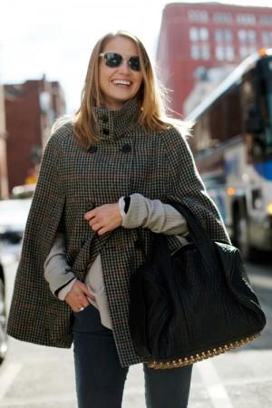 Girl wearing a cape coat