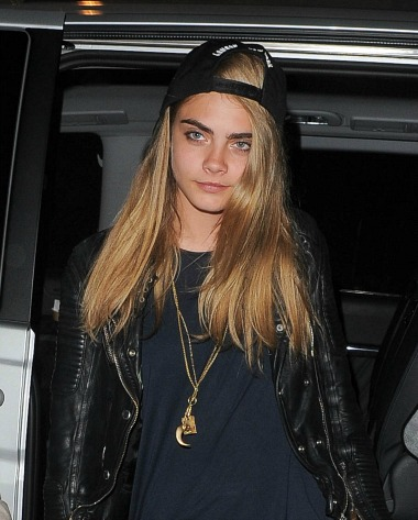 Cara Delevingne wearing a leather jacket