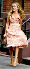 Carrie Bradshaw in the Sex and the City movie wearing a dress with a belt