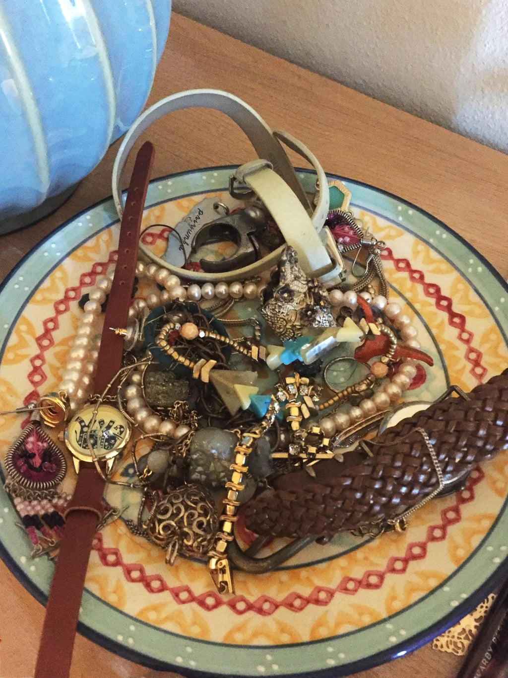 Catchall bowl/plate used to hold jewelry in an apartment