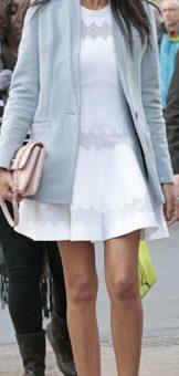 Chanel Iman wearing a white dress and powder blue coat
