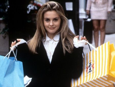 Cher from Clueless holding shopping bags