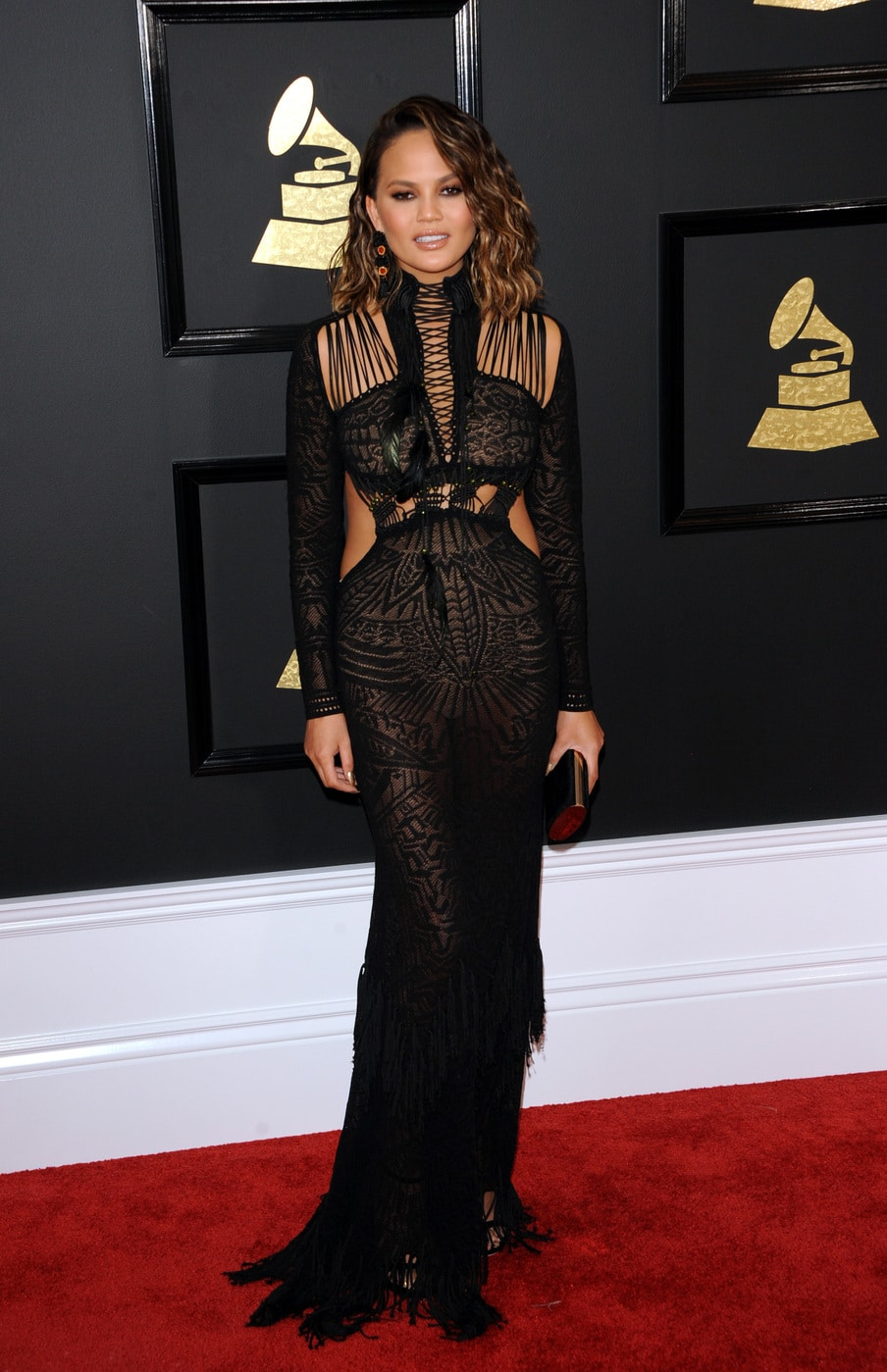 Chrissy Teigen in Roberto Cavalli black gown at the 2017 Grammy Awards