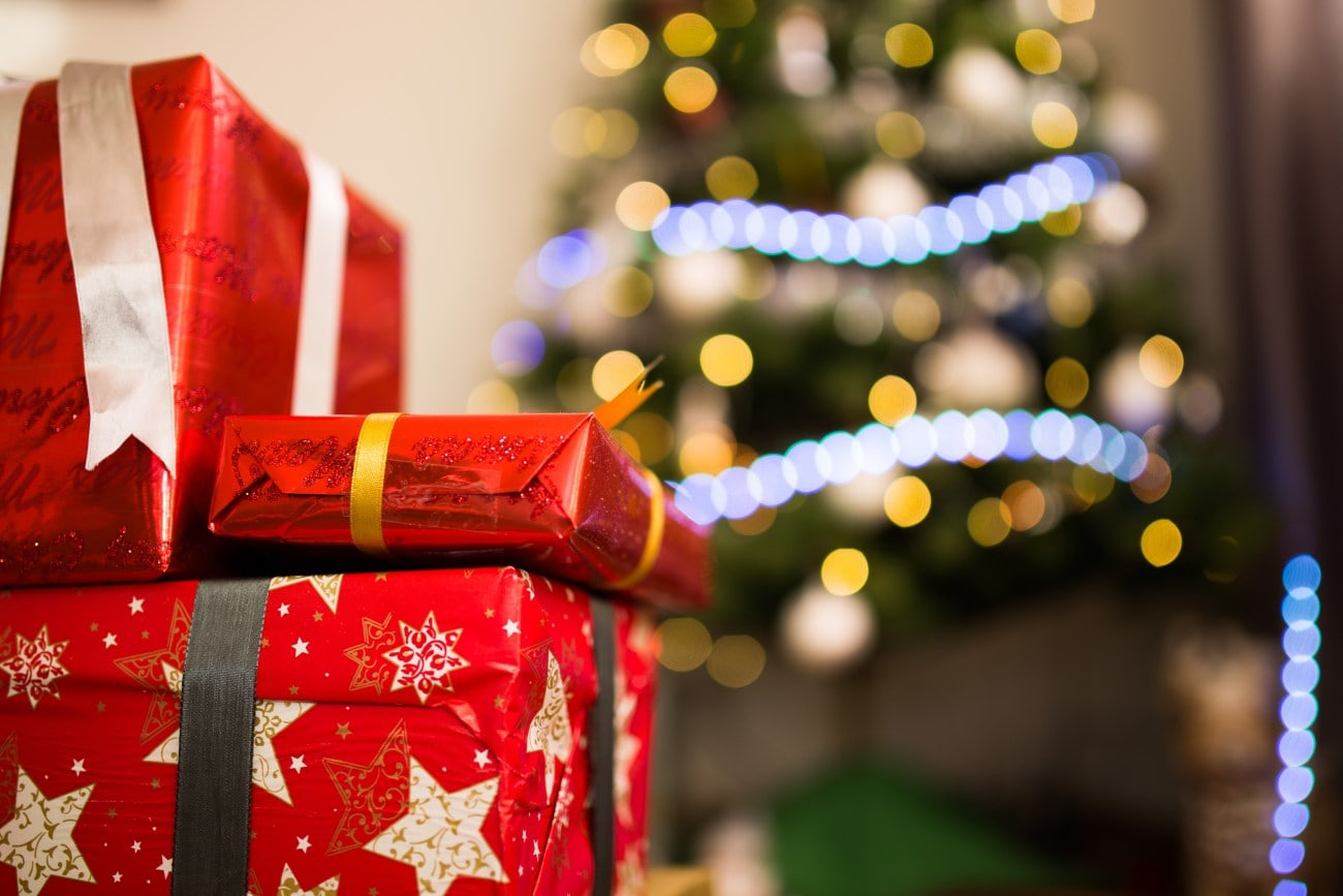 Christmas gifts with red and gold wrapping paper