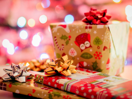 Christmas gifts with gold, red, and silver bows