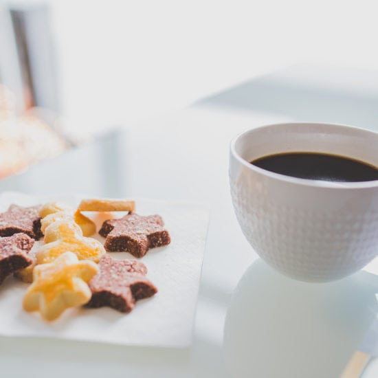 Christmas treats: Star shaped holiday cookies and a cup of coffee