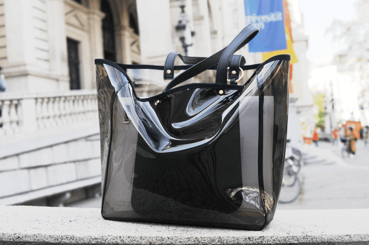 A clear black PVC tote bag on campus at University of Vienna -- perfect trendy bag for school