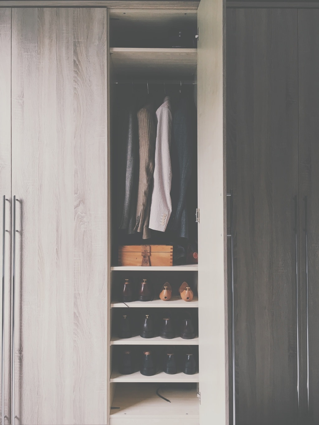 Closet with tops and shoes
