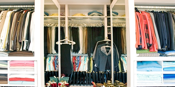 Large closet organized by color
