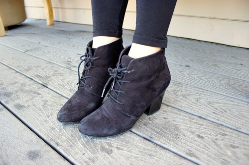 College fashionista rocking lace up black ankle booties