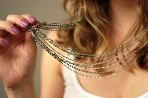 College fashionista wearing a layered necklace