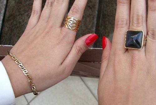 College fashionista wearing gold statement jewelry
