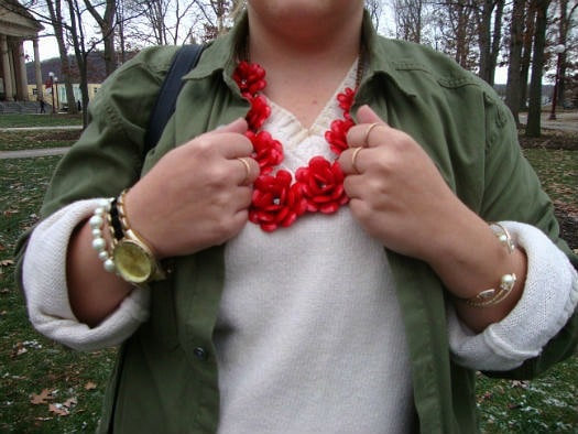 College fashionista wearing statement jewelry