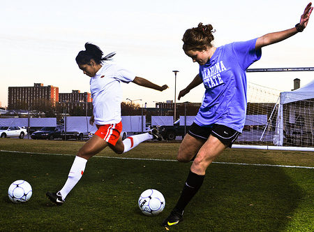 College girls playing soccer