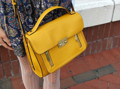 College student carrying a yellow handbag