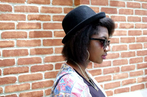 College student wearing a black bowler hat