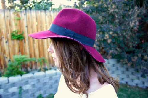 College student wearing a felt hat