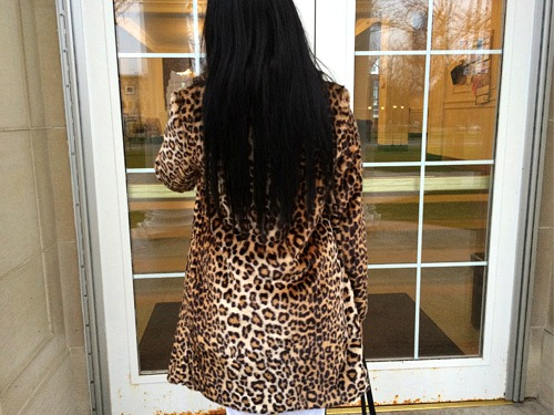 College student wearing a leopard print coat