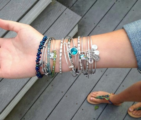 College student wearing Alex and Ani bangles