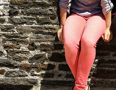 College student wearing colored skinny jeans