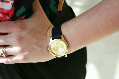 College student wearing gold and black watch