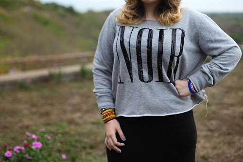 College student wearing graphic sweater