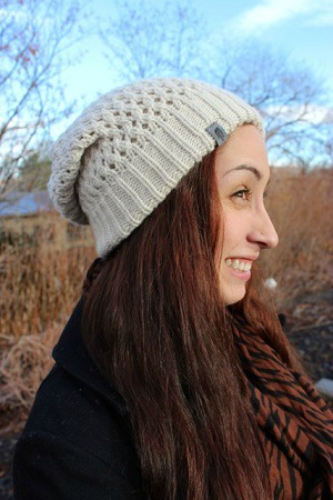 College student wearing knit beanie