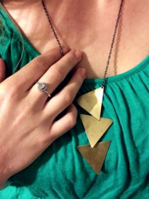 College student wearing mixed metal jewelry