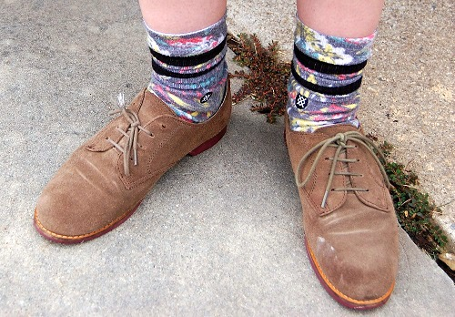 College student wearing printed socks and brown oxfords