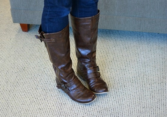College student wearing riding boots
