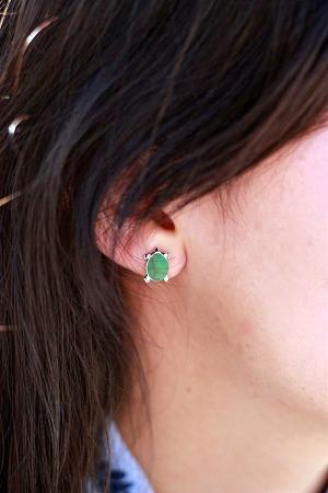 College student wearing turtle earrings