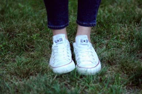 College student wearing white converse