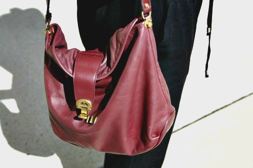 College student with burgundy bag