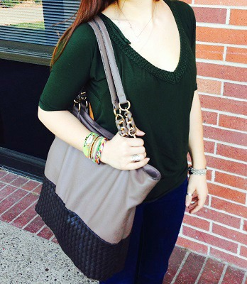 College student with gray handbag and stacked bracelets