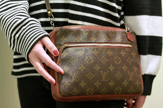 College student with Louis Vuitton bag