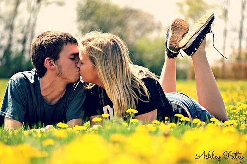 couple kissing in grass