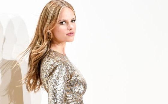 blonde woman in silver shimmer dress