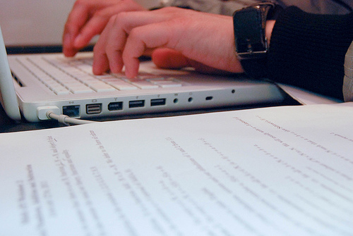 Writing a cover letter on a laptop