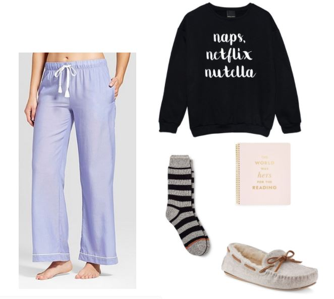 Study outfit for a night in: Purple pajama pants, a sweatshirt that reads Naps, Netflix, Nutella, cozy socks, slippers, and a Kate Spade notebook that reads The World Was Hers for the Reading