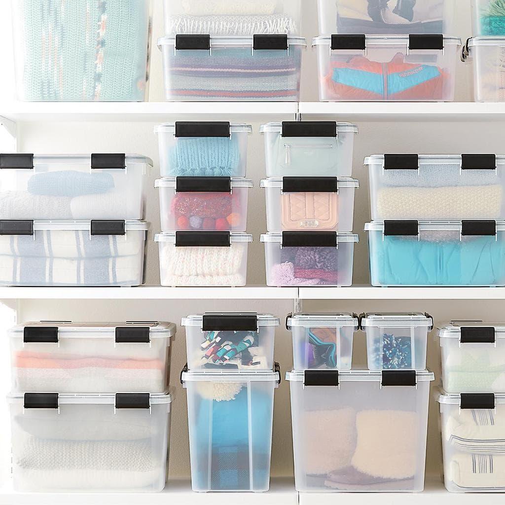 Weathertight clear storage bins for closet organization.