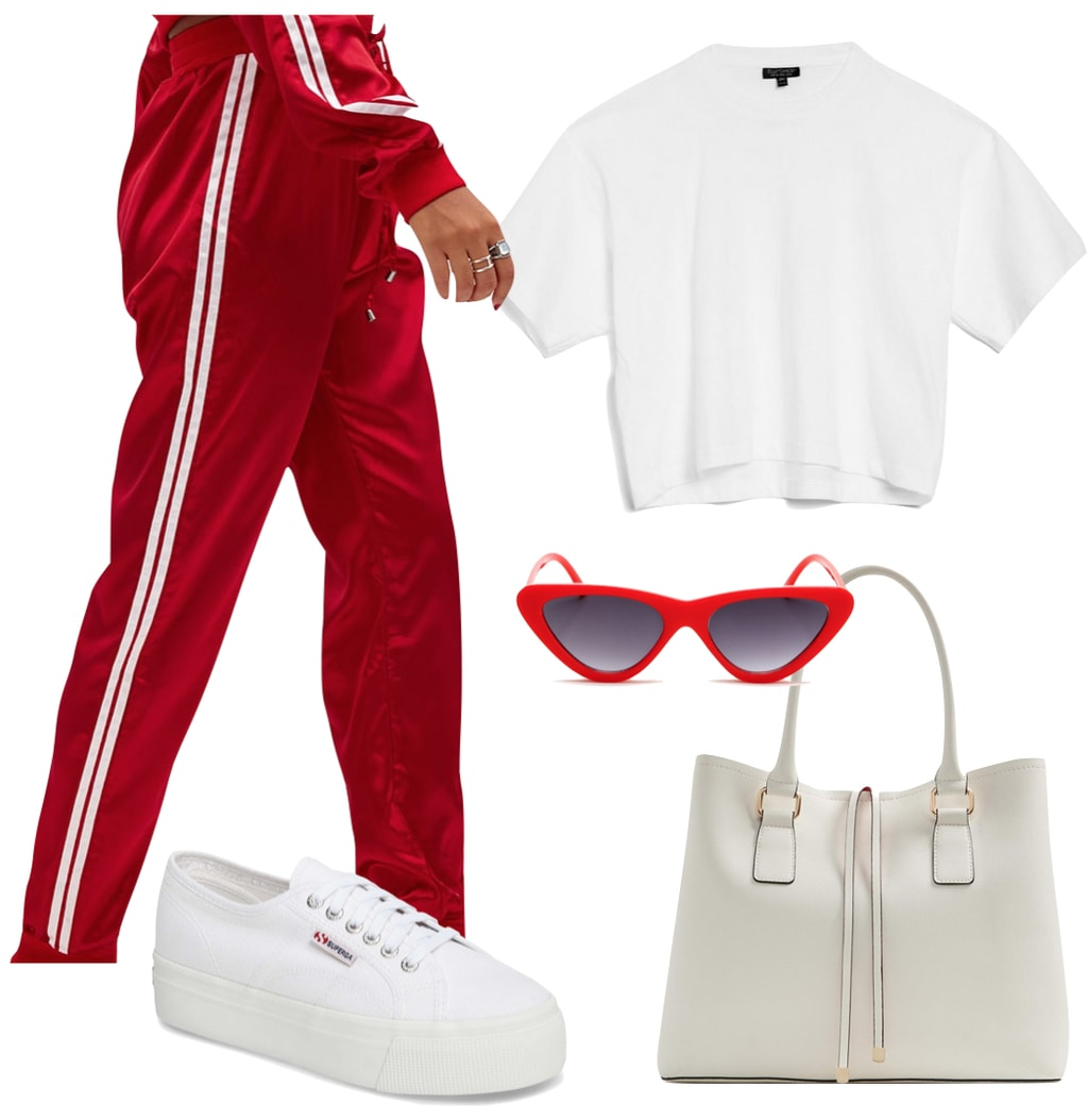 Dakota Fanning Outfit: red and white striped track pants, a white boxy t-shirt, red cat-eye sunglasses, a white handbag, and white platform low-top sneakers