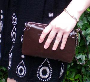 Danielle's brown clutch