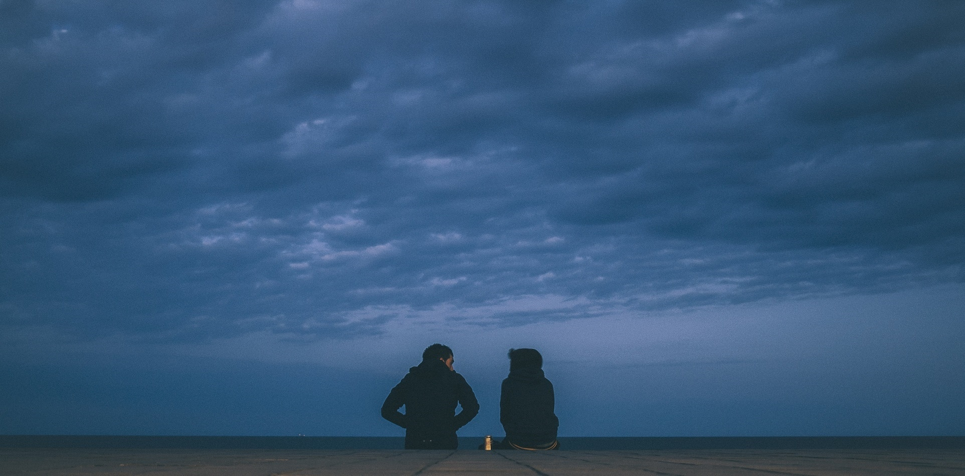 two people sitting blue clouds