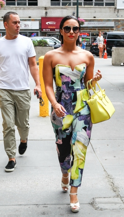 Demi Lovato wearing a colorful printed jumpsuit