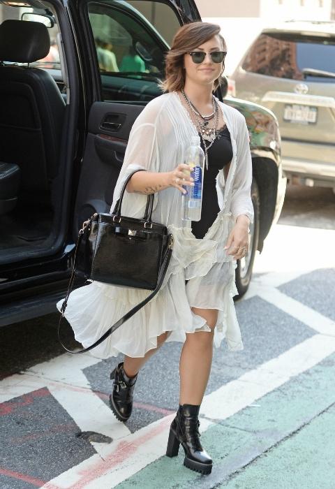 Demi Lovato wearing a white kimono jacket