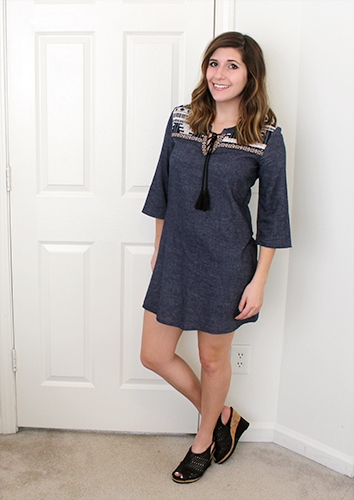 Denim dress with pattern on top, and wide bell sleeves.